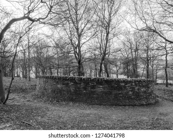 WAKEFIELD, YORKSHIRE, UK - DECEMBER 29, 2018: The Outclosure  dry stone sculpture by contemporary sculptor Andy Goldsworthy at the Yorkshire Sculpture Park