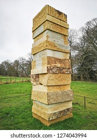 WAKEFIELD, YORKSHIRE, UK - DECEMBER 29, 2018: The Dale Stone Stack sculpture by contemporary artist Sean Scully at the Yorkshire Sculpture Park