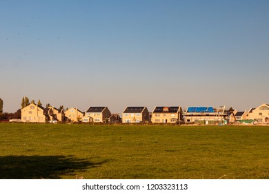 WAKEFIELD, YORKSHIRE, UNITED KINGDOM - OCTOBER 10, 2018: View of houses being built on Ackworth Road and Waterwood Close, from East Ardsley Reservoir