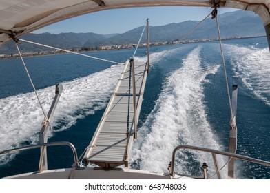 wakes created by a small boat in Kalamata bay, Greece