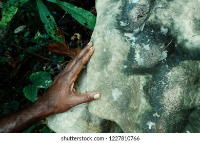 Walarano village, Malekula Island / Vanuatu - 9 JUL 2016 : local villagers hand with a rock which was used to inspect human intestines while cannibalism was practiced