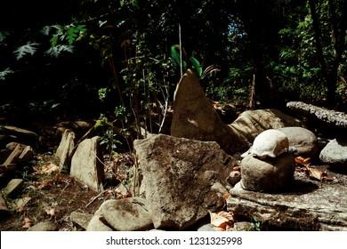 Walarano village, Malekula Island / Vanuatu - 9 JUL 2016 : human remains bones and scull at a traditional cannibal site next to a ground oven