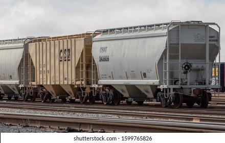 Walbridge, Ohio / USA - April 21, 2019: CSX Transportation grain cargo train cars on railway.