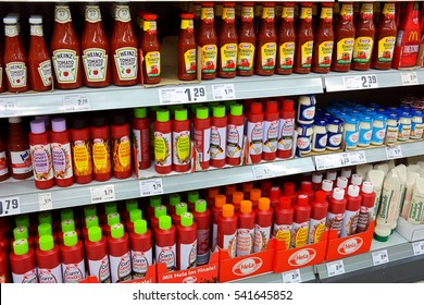 WALDFEUCHT, GERMANY - MAY 11,  2016: Shelves with a different range of ketchup products in a REWE supermarket, part of the REWE Group, German diversified retail and tourism group, operates in Europe.