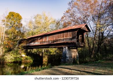Waldo, Alabama/USA-Nov. 10, 2018: The Waldo Covered Bridge, also known as the Riddle Mill Covered Bridge, spans Talledega Creek.