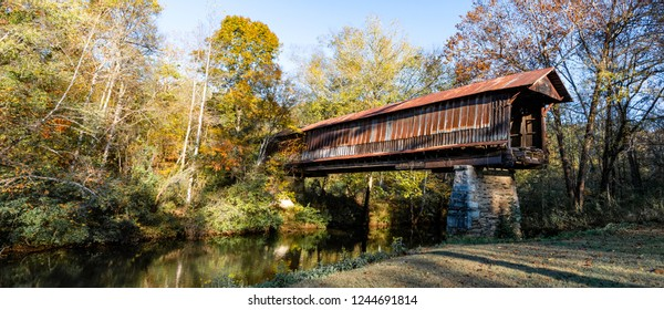 Waldo, Alabama/USA-Nov. 10, 2018: Panorama of the Waldo Covered Bridge, also known as the Riddle Mill Covered Bridge, spans Talledega Creek.