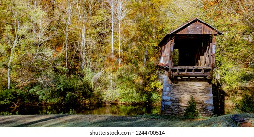 Waldo, Alabama/USA-Nov 10, 2018: Web banner of the historic Waldo Covered Bridge with autumn foliage in the background.  Built in 1858, this bridge is the 2nd oldest surviving covered bridge in AL.