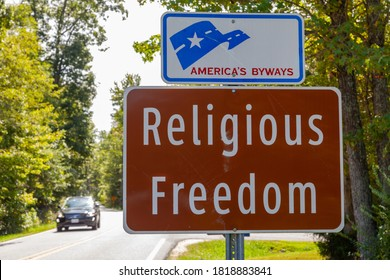 """Waldorf, MD, USA 09192020: road sign at the entry of one of Maryland's scenic byways named """"Religious Freedom"""" in reference to Southern Maryland being the cradle of religious liberty in the USA."""