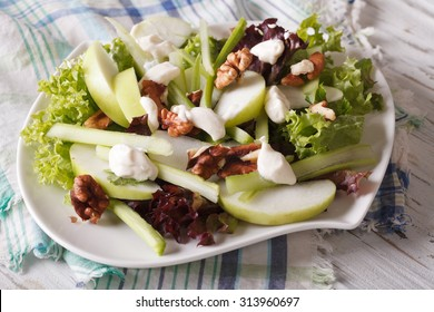 Waldorf Salad with apples, celery and walnuts close-up on a plate. horizontal