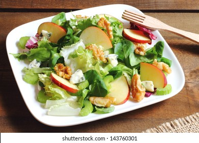 Waldorf salad made of fresh apples, celery and walnuts