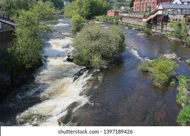 Wales the lovely market town of Llangollen. The river Dee surges towards the town bridge on a crisp sunny spring day.