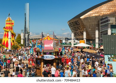 Wales, Uk, August 27, 2017.  A crowd of people enjoying themselves at  Cardiff Bay, Cardiff