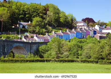 Wales, UK, June 4, 2013. Bridge over the River Towy with Colorful Houses, llandeilo, Carmarthenshire