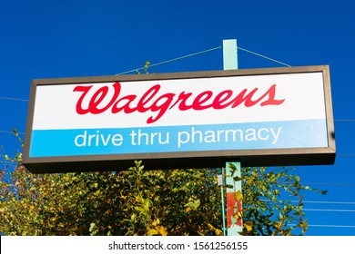 Walgreens, drive thru pharmacy pilon sign. Walgreen Company is an American company that operates as the second-largest pharmacy store chain in the United States - Palo Alto, CA, USA - 2019