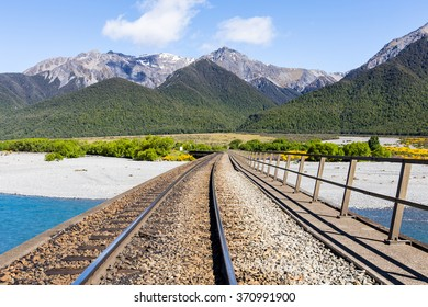 walk all around the Railroad,mountain background with a lovely cloudy and blue sky in the river