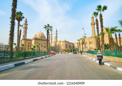 Walk along the green Sah El-Deen Square with a view on its beautiful landmarks - Sultan Hassan Mosque-Madrasa, Al Rifai' (Royal) Mosque and Al-Mahmoudia Mosque, Cairo, Egypt.