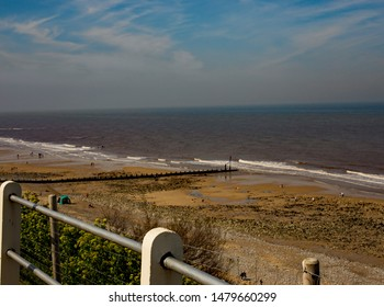 A walk along the Norfolk Coastal path and a view over the beach and North Sea at Cromer, on the Norfolk coast.