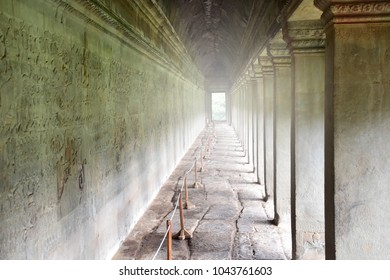 walk along the path seeing the  art on wall inside Angkor Wat, Cambodia