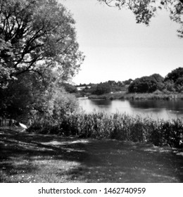 walk along the river erne, this black and white camera obscura photo is NOT sharp due to camera characteristic. Taken on analogue photographic large format negative film with a pinhole camera