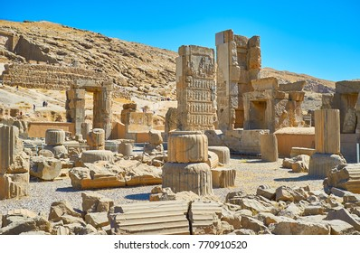 The walk among the ancient ruins of the Persepolis complex, famous ceremonial capital of Persian Empire, Iran.