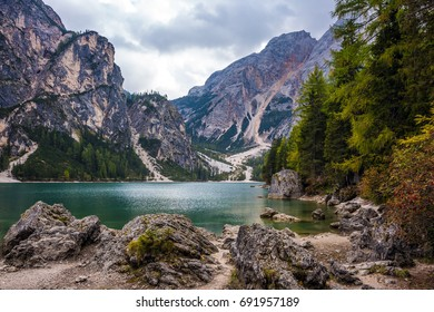Walk around the beautiful Alpine lake Lago di Braies. Travel to the Southern Tyrol, Italy. Concept of pedestrian and ecological tourism