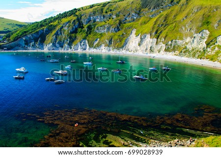 A walk around the beautiful Lulworth Cove in Dorset south west England one hot summers day in early July