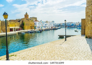 Walk around the old port and enjoy historical architecture of Bizerte, its extant citadels, traditional houses of Arab Medina, fishing boat, moored at shores and vintage lanterns, Tunisia