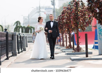 A walk of the bride and her husband 40 years along the embankment