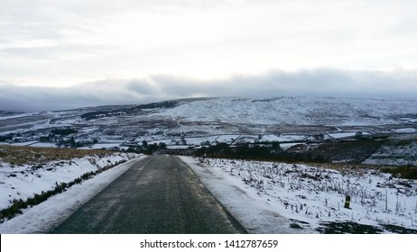 walk down from the top of dale view white clouds conect to snow cover the road on the dales, beautiful white  scene winter  at Arkengarthdale, North Yorkshire