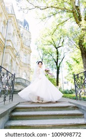 A walk of a happy bride in the city
