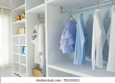 walk -in closet with cloth and shelf at home