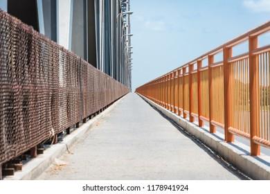 Walk lane for people to cross the river with metal bridge, Mandalay - Myanmar