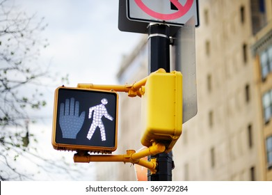 Walk New York traffic sign on blurred background
