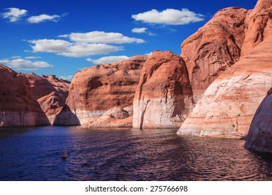 Walk on the boat at sunset. Lake Powell is surrounded by magnificent red hills. Scenic huge artificial water basin of the Colorado River, USA