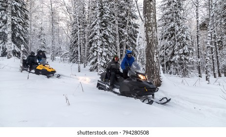 Walk on snowmobiles in the mountains of the Urals.