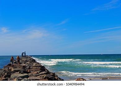 Walk over break waves