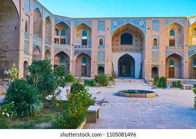 The walk in scenic garden of Ganjali Khan Caravanserai - medieval city landmark, located in complex of Grand Bazaar, Kerman, Iran.
