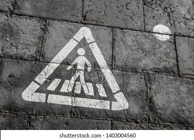 Walk sign, pedestrian street sign on a wet dark tile floor