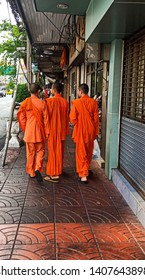 Walk and talk on the way back to the temple. Street life style picture from bangkok Thailand.