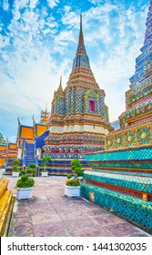 Walk in Wat Pho complex and enjoy splendid tiled stupas of Phra Maha Chedi shrine in thai-chinese style, Bangkok, Thailand