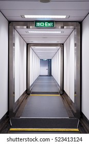 Walk way in the airbridge from airplane to terminal, selective focus.