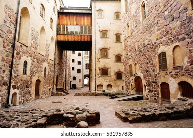 Walk way between building and pattern of windows at Turku castle.  Medieval building in the city of Turku in Finland. It was founded in the late 13th century and stands on the banks of the Aura River