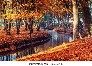 Walk way bridge over river with colorful trees in autumn time