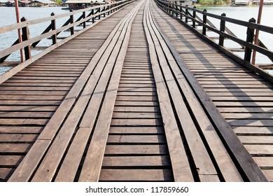 Walk way on old wooden bridge in Thailand