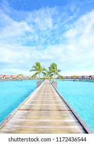 Walk way through water villa with coconut tree and blue sea and sky