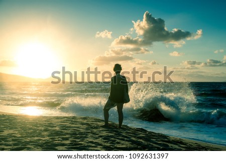 Walk of a woman on the island of Sardinia, Sunset on the Mediterranean