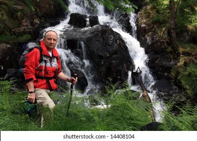 Walker at a waterfall