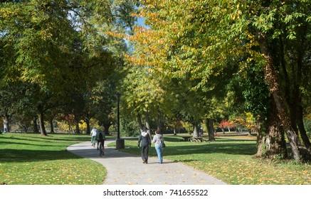 Walkers and bike riders enjoy the bike path beside the Willamette River in Skinner Butte Park in October.