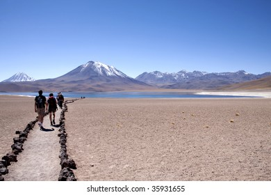 Walkers in Lagunas Miscanti and Meniques in the desert of the atacama near the Andes Cordillera