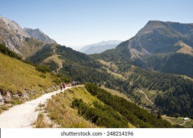 Walkers on one of the many hiking routes around the alpine scenery of the Berchtesgaden, Bavaria, Germany.